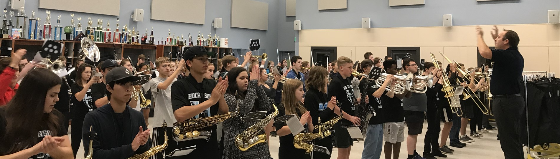 High school band members playing and clapping